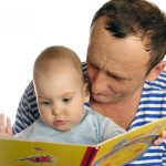 Shutterstock_Caucasian Father and Infant Reading a Book